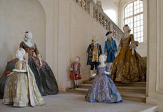 Baroque or victorian clothes and dresses. Victorian or baroque clothes for men, women, children on display Stock Photo
