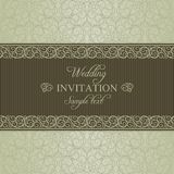 Baroque wedding invitation, dull gold. Baroque wedding invitation card in old-fashioned style, dull gold on beige background Stock Photos