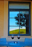 Barossa Valley Vineyard reflected in window in front of Wine Table for Two in Australia. Barossa Valley Vineyard reflected in window in front of Wine Table for stock image