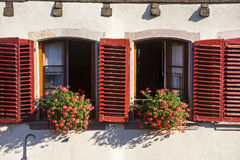 Barr (Alsace) Two windows with red shutters Stock Image