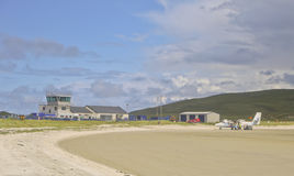 Barra Airport Showing Beach in Foreground. A general view of the Barra Airport, Barra, Scotland, UK. The airport buildings on the left, a Dehavland Twin Otter Stock Photo