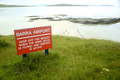 Barra Airport Sign. The Barra Airport sign beside the beach, Isle of Barra, Outer Hebrides, Scotland, at high tide Royalty Free Stock Images