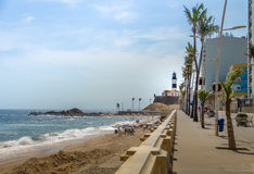Barra Beach with Farol da Barra Barra Lightouse on Background - Salvador, Bahia, Brazil Stock Photography