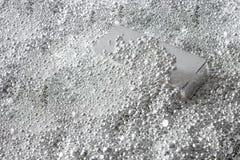 Barra d'argento nei pezzi di argento fotografie stock libere da diritti