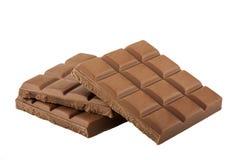 Barra de chocolate aislada en el fondo blanco Fotografía de archivo