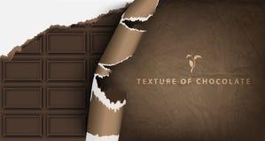 Barra de chocolate en el empaquetado de papel Fotos de archivo
