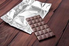 Barra de chocolate en envoltura Foto de archivo