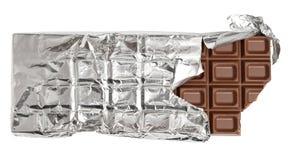 Barra de chocolate mordida do leite Fotos de Stock
