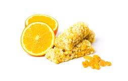 Barra de energía de la miel con la naranja y las pasas Fotografía de archivo libre de regalías