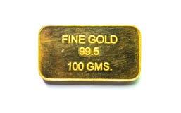 Barra de la galleta del oro en un fondo blanco Imagen de archivo libre de regalías