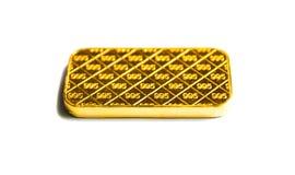 Barra de la galleta del oro en un fondo blanco Fotografía de archivo
