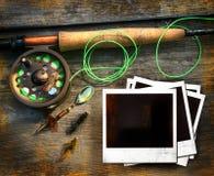 Barra de pesca de mosca con los cuadros   Fotos de archivo