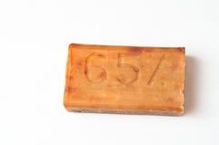 Barra del sapone di lavanderia giallo Fotografie Stock