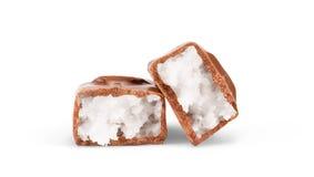 Barra di cioccolato su priorità bassa bianca Fotografia Stock