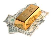 Barra di oro con le banconote Fotografia Stock Libera da Diritti