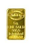 barra di oro 5g su fondo bianco Immagine Stock