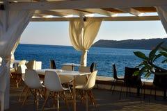 Barra do café da margem no por do sol Fotografia de Stock Royalty Free