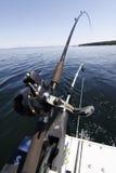 Barra y carrete de pesca de Downrigger Imágenes de archivo libres de regalías