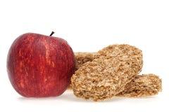 Barra y manzana del cereal Imagen de archivo libre de regalías