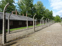 Barracks and fence in the former concentration camp. Auschwitz Stock Images