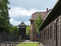 Barracks, fence and watchtower in the former concentration camp. Auschwitz Royalty Free Stock Photos