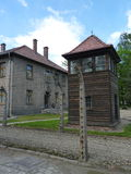 Barracks, fence and watchtower in the former concentration camp. Auschwitz Stock Image