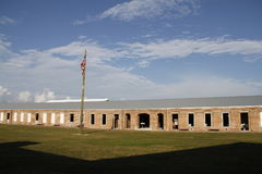 Barracks at Fort Zachary Taylor with the United States flag in foreground. Fort Zachary Taylor Historic State Park was active between 1845-1947 and is located Stock Photos