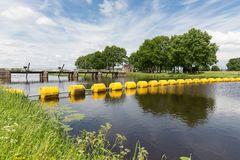 Barrage in Dutch river Vecht with floating barricade Royalty Free Stock Photography
