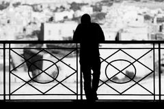 Barrakka Silhouette. A young man takes in the majestic view of the Grand Harbour and beyond at the Upper Barrakka Gardens in Malta Stock Photos