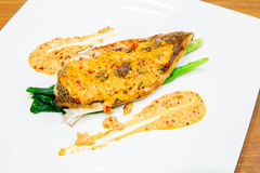 Barramundi steak with spicy sauce Stock Photo