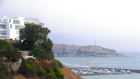 Barranco south view from the Lima coast with a marina in the Pacific Ocean and a modern building over a cliff. Panoramic view from a cliff of Lima, to the south Stock Image