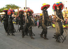 Barranquilla's Carnaval. BARRANQUILLA, COLOMBIA- FEBRUARY 02: Group of a young people in a traditional black masquerades on a carnival in the city of Stock Photo