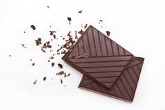 Barras de chocolate aisladas en blanco Imagen de archivo libre de regalías