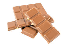 Barras de chocolate do leite com as avelã isoladas em um fundo branco Foto de Stock Royalty Free