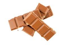 Barras de chocolate do leite com as avelã isoladas em um fundo branco Fotos de Stock Royalty Free