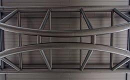 Barras de hierro en la pared Foto de archivo libre de regalías