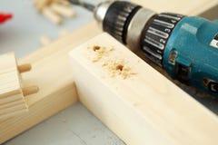 Barras de madera que son perforadas Imagen de archivo libre de regalías