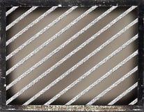 Barras de metal abstractas del fondo dentro del marco negro Foto de archivo