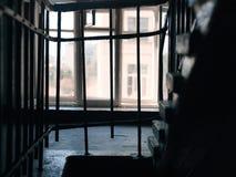 Barras de metal na janela imagem de stock royalty free