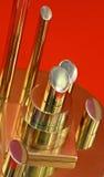 Barras de metal pulidas en un fondo rojo Imagen de archivo libre de regalías