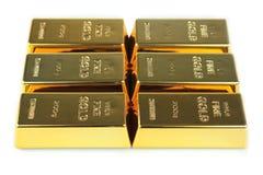 Barras de oro en el fondo blanco Imagen de archivo