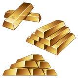 Barras de oro en el fondo blanco Fotografía de archivo