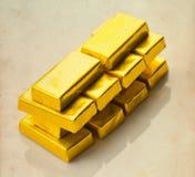 Barras de oro en fondo de papel envejecido Foto de archivo