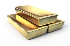 Barras de oro en la superficie blanca Fotografía de archivo