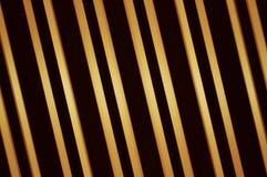 Barras de oro paralelas Foto de archivo libre de regalías