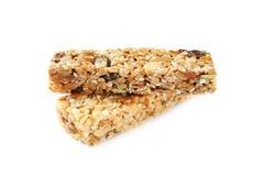 Barras diferentes do cereal da grão no fundo branco imagens de stock