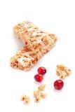 Barras do cereal com trigo e as airelas soprados Fotos de Stock Royalty Free