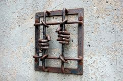 Barras e mãos da prisão Imagens de Stock Royalty Free