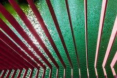 Barras y agua de hierro Fotos de archivo libres de regalías