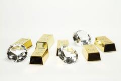 Barras y diamantes de oro Fotografía de archivo libre de regalías